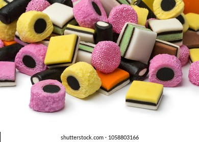 Heap of colorful Liquorice allsorts on white background