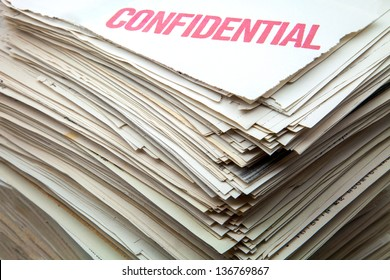heap of confidential documents of role