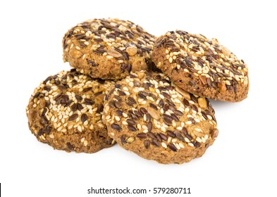 Heap of cookies with sesame and sunflower seeds isolated on white background