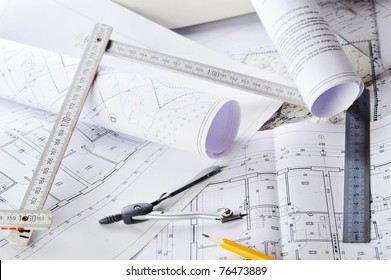 heap of design and project drawings on  table