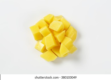 heap of diced potatoes on white background