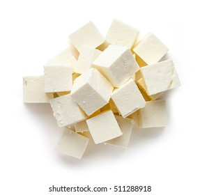 Heap of diced soft cheese isolated on white background, top view