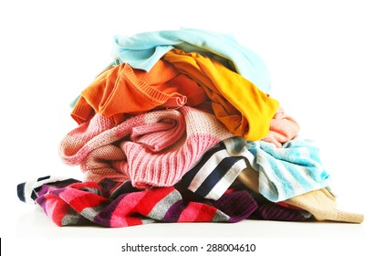 Heap of different clothes, isolated on white