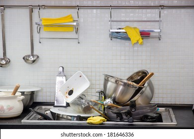 Heap of dirty utensil on the kitchen