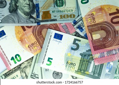 Heap of Dollar and euro Bills on white background. Dollar and euro Closeup Concept. Dollar and euro Cash Money.  Banknotes. Cash of Dollar and euro bills, money background.
