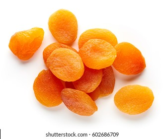 Heap of dried apricots isolated on white background, top view