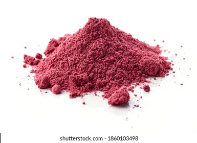 heap of dried beet root powder macro isolated on white background, selective focus