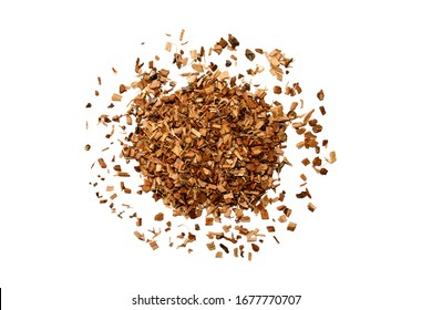 Heap of dried brown oak bark isolated on white background for medical use. Oak bark pile. Quercus cortex - herb.