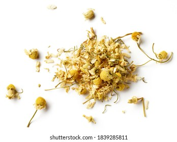 Heap of dried Chamomile tea isolated on white background; top view