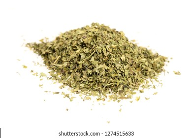 Heap of dried cilantro leaves isolated on a white background.