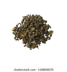 Heap of dried herbal tea leaves isolated on white. Top view of tea Milky Oolong.