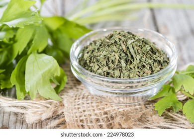 Heap of dried Lovage on weathered wooden background