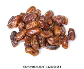 Heap of dried pitted dates isolated on white background