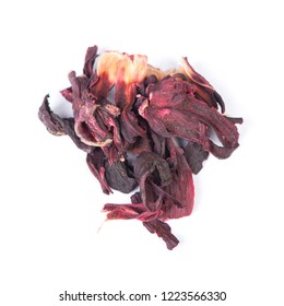 Heap of dried roselle flower tea carcade isolated on white