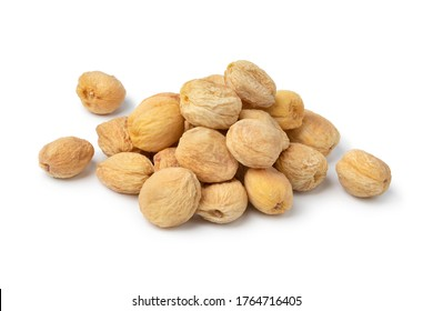 Heap of dried sweet orange apricots with seed inside without preservatives isolated on white background