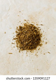 Heap of dried Valerian root ( Valeriana officinalis ) isolated on paper background