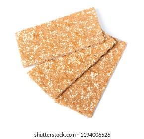 Heap of dry flat breads isolated on white background