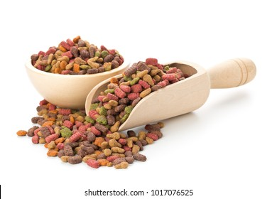 Heap of dry pet food in wooden bowl and wooden scoop over white background