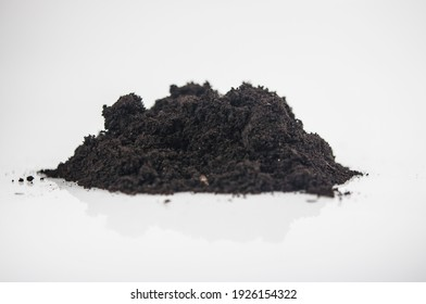 Heap of earthen pile on white background