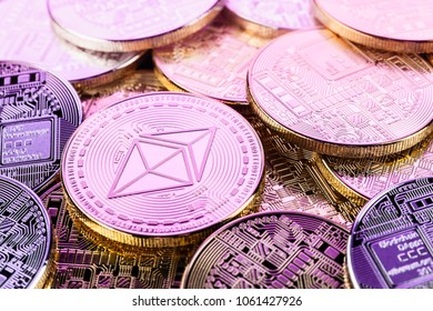A heap of Ethereum (ETH) physical golden and shiny coins seen from above. Ethereum is a digital blockchain cryptocurrency