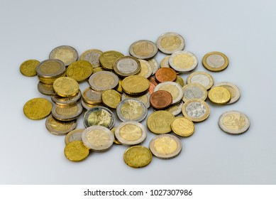 A heap of euro coins from different countries on an white background