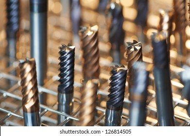 heap of finished metal thread tap tools with protective coating