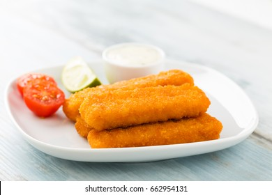 Heap of fish fingers with homemade tartar sauce