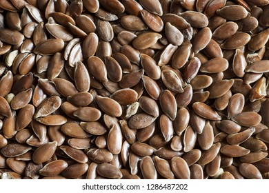 Heap of Flax seeds or linseeds. Flaxseed or linseed concept. Flax seed dietary fiber background