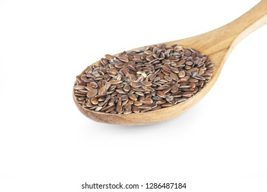 Heap of Flax seeds or linseeds in spoon isolated on white background. Flaxseed or linseed concept. Flax seed dietary fiber background