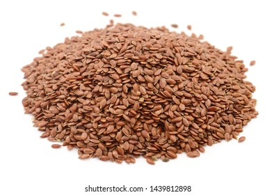 Heap of flax seeds on a white background.