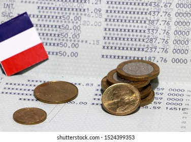 Heap of French franc coin money and mini France flag on the book bank. Concept of Saving money or finance.
