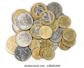 heap of french francs money coins and centimes in different values isolated on white, top view, ancient french currency