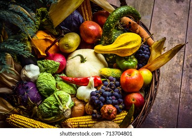 Heap of fresh fruits and vegetables in basket. Autumn concept