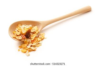 Heap of fresh musli with raisin in wooden spoon
