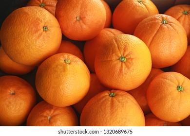 heap of fresh oranges, close-up, full frame