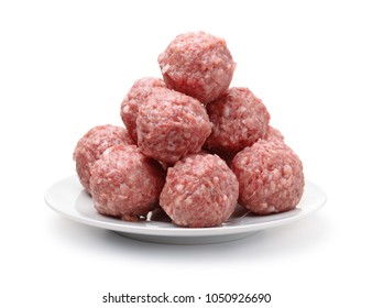Heap of fresh raw meatballs on plate isolated on white