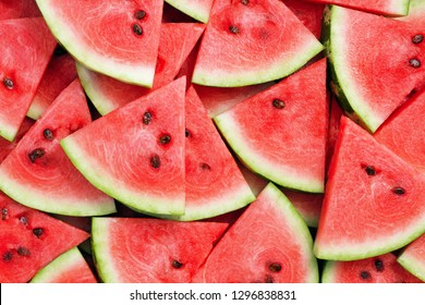 heap of fresh sliced watermelon as textured background