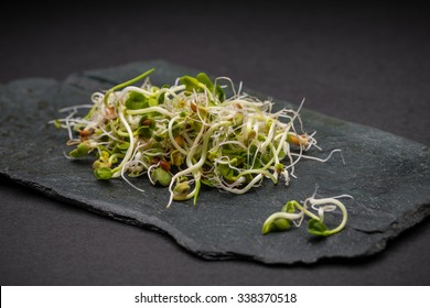 Heap of fresh sprouts on black slate surface
