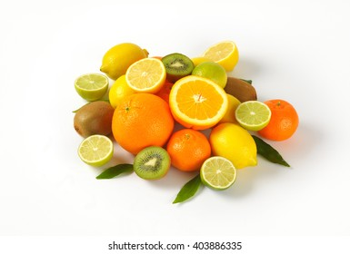 heap of fresh tropical fruit on white background
