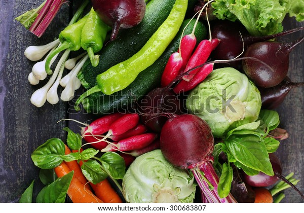 Heap of fresh vegetables on table close up