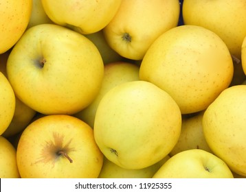 Heap of fresh yellow apples on peasant market