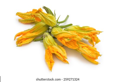 Heap of fresh zucchini flowers. Isolated on white background.