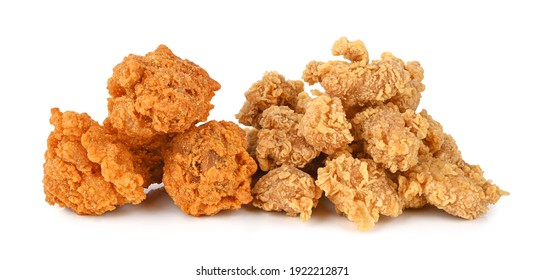 Heap of fried spicy chicken and popcorn chicken isolated on white background.