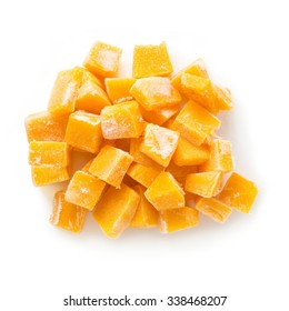 Heap of frozen pumpkin isolated over white, top view