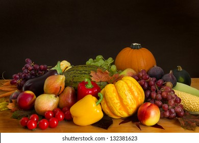 Heap of fruit and vegetables in colorful shades of red, yellow and oranges