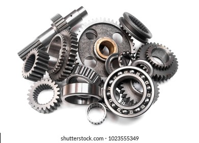 heap of gears and bearings on a white background not isolated, is present small noise