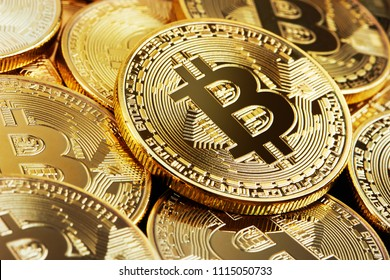 Heap of Golden Bitcoin closeup