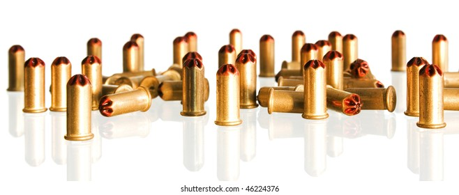 heap of golden bullets on a white background