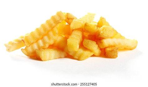 Heap of golden fried crinkle cut potato chips or French fries for a delicious snack or appetizer isolated on white