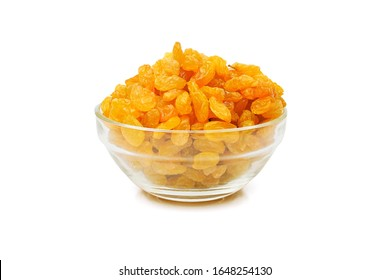 heap of golden sultana raisins in a glass bowl isolated on white background